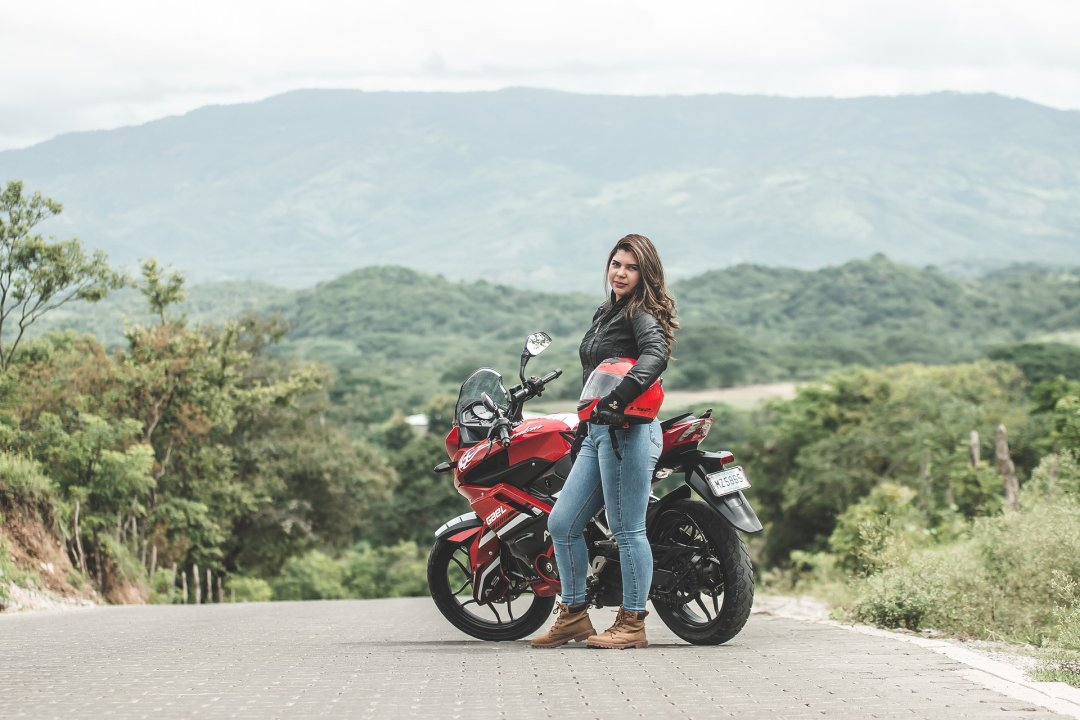 Women wearing motorcycle jacket, jeans and ankle boots