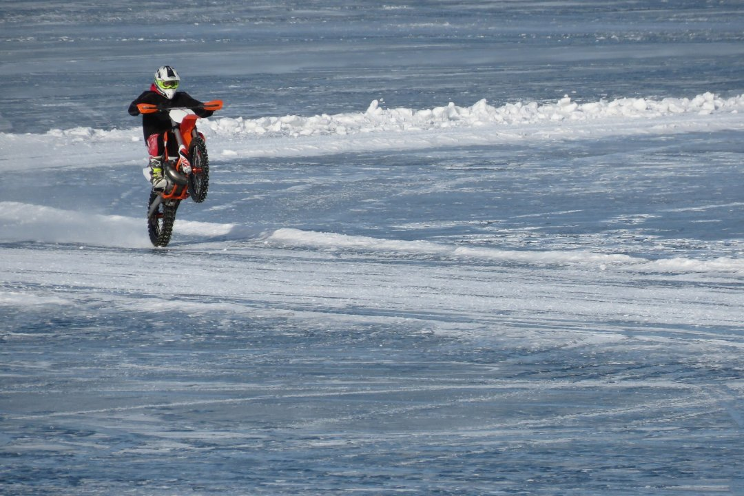 Motorcyclist riding his motorbike on ice